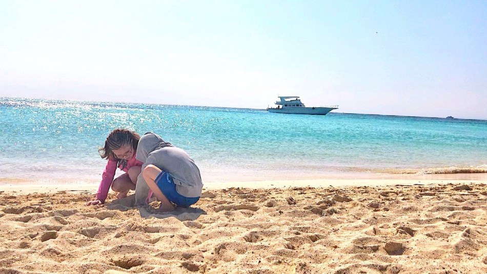 Children playing on the sand at Giftun island, Holidays to Hurghada, Egypt