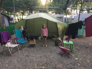 girl outside tent in campsite in Spain