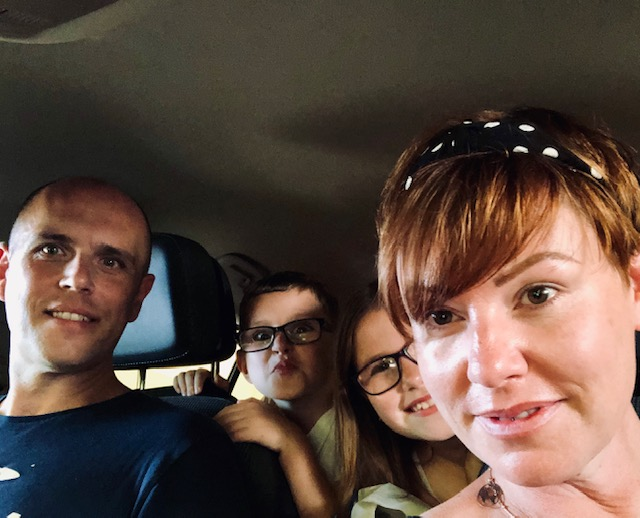 Family in car travelling on the Eurotunnel from UK to France